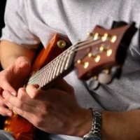 Learn Guitar Online? What You Need To Know Before Taking Guitar Lessons Online