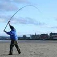 Surfcasting on the Beach With Safety Precaution